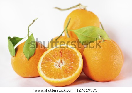 Oranges on White Background. Selective Focus.