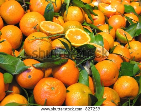 oranges with leafs - stock photo