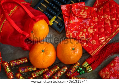 Oranges with Red Lucky Pouches and Firecracker Prepared for a Chinese New Year - stock photo