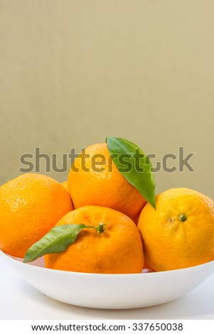 Oranges with space for letters and text on the side.