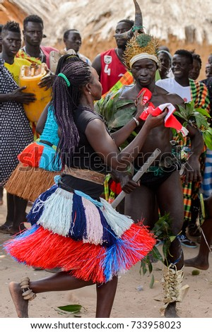 ORANGO ISL., GUINEA BISSAU - MAY 3, 2017: Unidentified local Men and women dance a national dance  during Vaca Bruto, traditional Mask dance