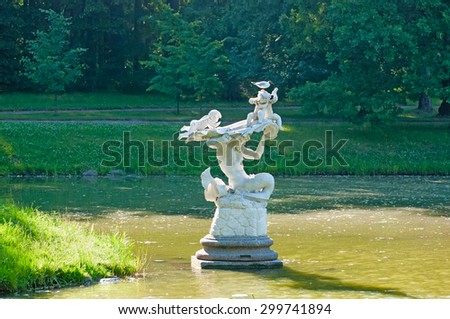 ORANIENBAUM, SAINT-PETERSBURG, RUSSIA - JULY 3, 2015: The Triton Sculpture in the Chinese Pond in Upper Park. Oranienbaum Palace and Park Ensemble is the State Museum-Preserve - stock photo