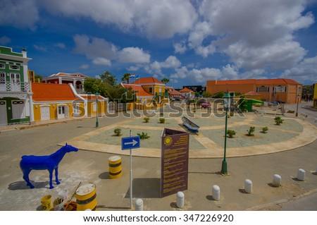 ORANJESTAD, ARUBA - NOVEMBER 05, 2015: Streets of Aruba Island, downtown shopping district with tram tracks - stock photo