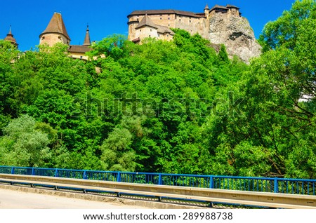 Orava Castle seen from the bridge on the river, one of the most beautiful Slovak castles, Orava Podzamcze, Slovakia - stock photo