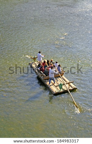 ORAVSKY PODZAMOK, SLOVAKIA - SEPTEMBER 28: Cruise on wooden rafts down the river Orava on September 28, 2008. Orava belongs to one of the most typical natural and historical regions of Slovakia.
