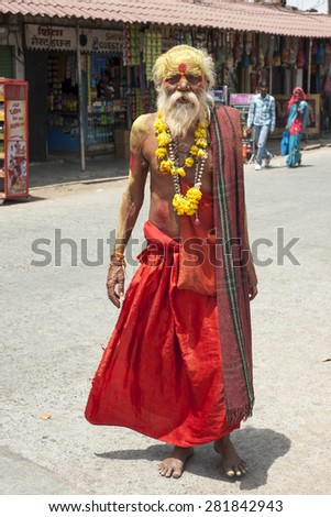 ORCHA,INDIA -  APRIL  24, 2015: A holy Sadhu man with traditional painted face in Orchha, Madhya Pradesh, India .April 24, 2015