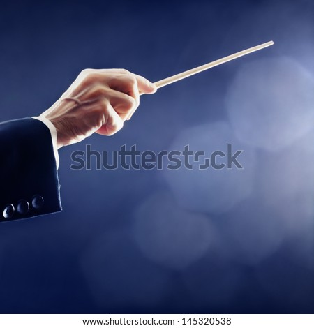 Orchestra conductor hands baton. Music conducting director holding stick - stock photo