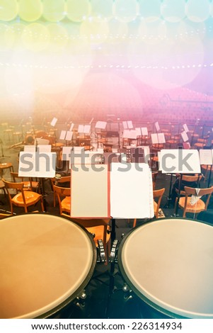 Orchestra Seats and Timpani on Stage - stock photo