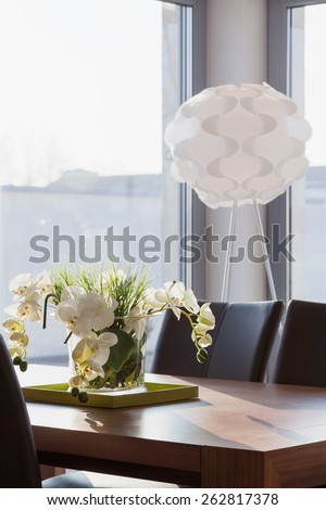 Orchid on the table in contemporary interior - stock photo