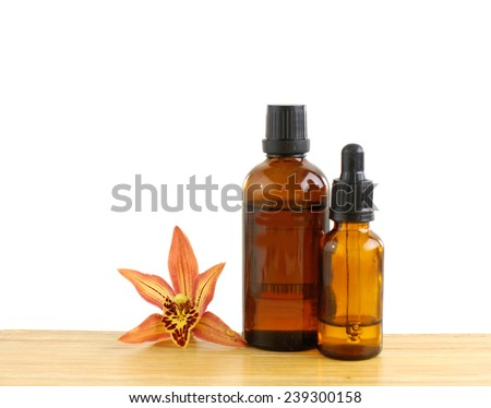 Orchid with massage oil and wooden board