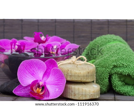 orchids  and spa settings on bamboo mat border isolated on white background - stock photo