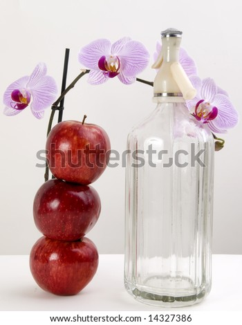 Orchids, apples and soda isolated on white and gray - stock photo
