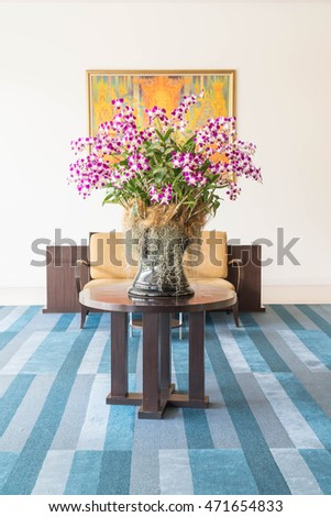 orchids bouquet flower decoration in living room interior background