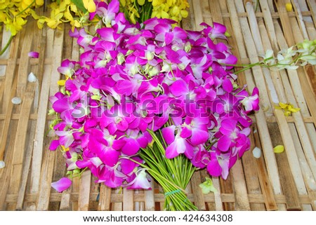 orchids flowers laying on wicker bamboo