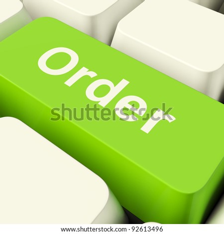 Order Computer Key In Green Showing Online Purchases And Shopping - stock photo