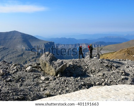 ORDESA, SPAIN. July 16, 2015. Two mountaineers observe the landscape at Ordesa y Monte Perdido Natural Park, Pyrenees.
