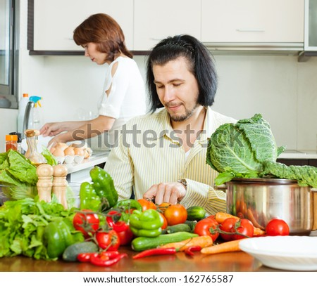 Ordinary couple   in home kitchen