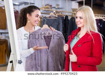 Ordinary european women shopping winter outwear at the apparel store
