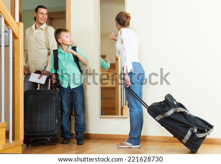 Ordinary family travelers with luggage  going on holiday