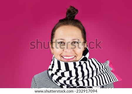 Ordinary middle-aged woman au naturel on pink background - stock photo