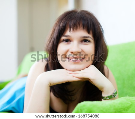 ordinary woman lying on couch in livingroom room