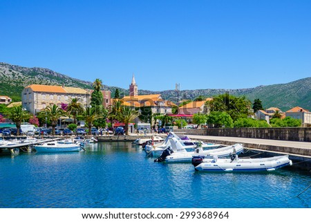 Orebic, CROATIA - JUNE 25, 2015: Scene of the port, and the town center, with locals and tourists, in Orebic, Croatia