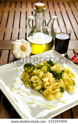 Orecchiette with broccoli with ingredients, italian pasta - stock photo