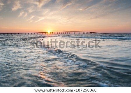 Oregon Inlet Herbert Bonner Bridge Sunset Outer Banks North Carolina - stock photo