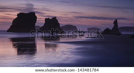 Oregon's Bandon Beach at sunset - stock photo