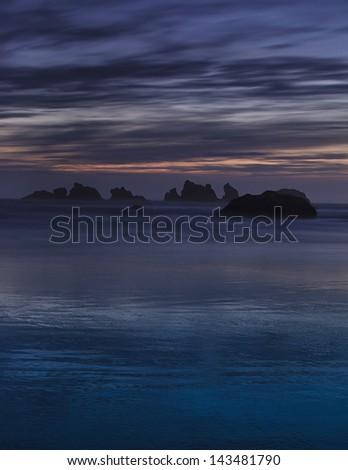 Oregon's Bandon Beach at sunset - stock photo