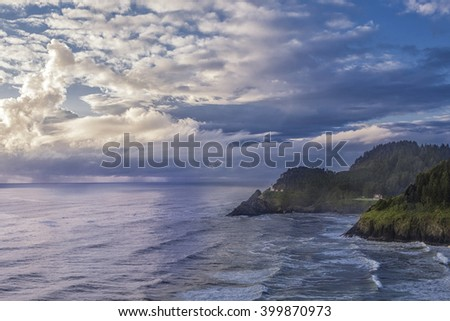 Oregon's Heceta Head LIghthouse under clearing skies