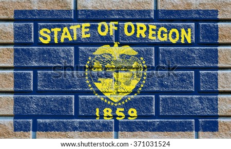 Oregon state flag of America on brick wall - stock photo