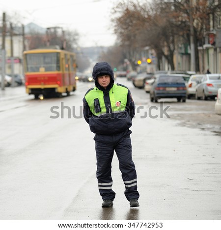 Orel, Russia - December 05, 2015: Truck drivers picket. Road policeman on empty street with tramway