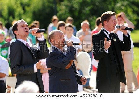 Orel, Russia - July 08, 2016: Russian Valentine Day  - Petr and Fevronia. Men in suits singing
