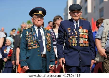 Orel, Russia - May 9, 2016: Celebration of 71th anniversary of the Victory Day (WWII). Old war veterans in uniform with medals