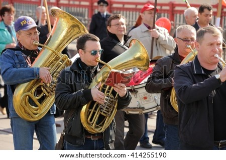 Orel, Russia - May 1, 2016: Communist party demonstration. Brass band playing and marching