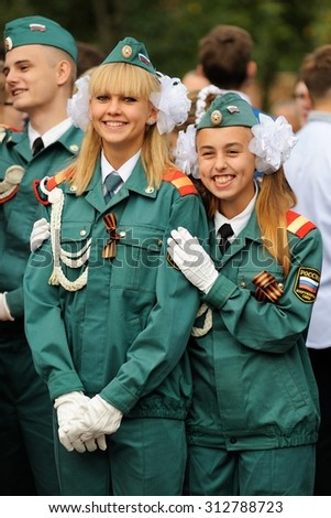 Orel, Russia - September 1, 2015: Two school blonde girls in parade uniform smiling