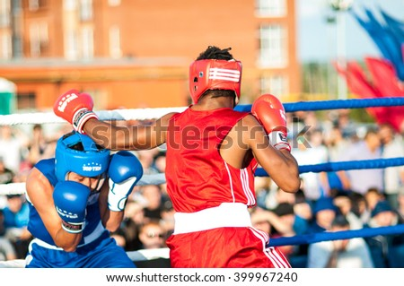 ORENBURG, ORENBURG region, RUSSIA, 25 July, 2014 year. Match meeting Russia on Boxing, Cuba. A boxing match Javier Ibanez, Cuba and Malik Bajtleuov, Russia. Defeated Javier Ibanez