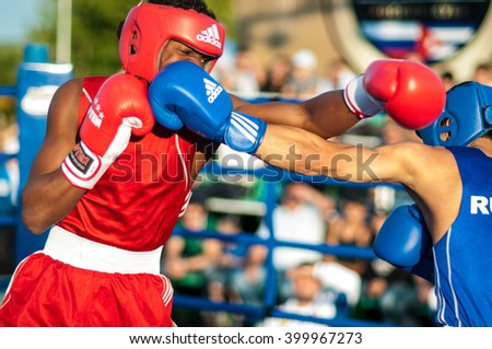 ORENBURG, ORENBURG region, RUSSIA, 25.07. 2014 year. Youth meeting on the boxing match between Russia and Cuba. A boxing match between Alayn Limonta (Cuba, Havana) and Gabil Mamedov (Russia, Orenburg)
