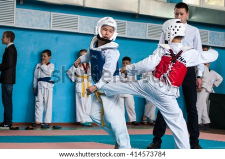 Orenburg, Russia - 23 April 2016: Taekwondo competitions among boys on Open Championship Orenburg city among boys and girls born between 2005-2007. - stock photo