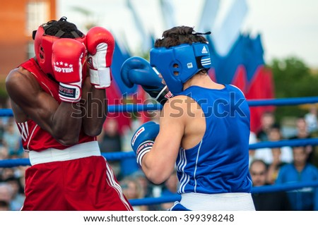Orenburg, Russia - 25 July 2014 year: A boxing match between Yordan Hernandes (Cuba) and Daniel Khlebnikov (Russia) during youth meetings in the boxing tournament between Russia and Cuba