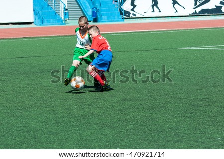 "Orenburg, Russia - 31 May 2015: The boys play football at the competition ""Lokobol-2015""."