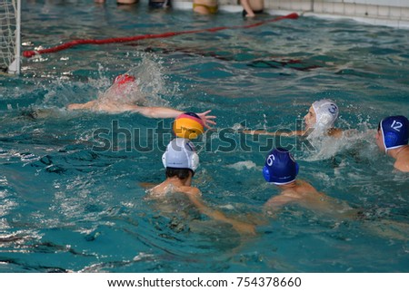 Orenburg, Russia - May 4, 2017  the boys play water polo at the city water polo tournament