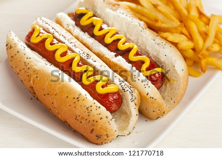 Organic All Beef Hotdog on a bun with mustard - stock photo