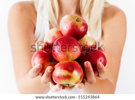 Organic apple in human hands. - stock photo