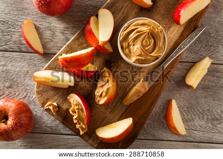 Organic Apples and Peanut Butter to Snack on - stock photo