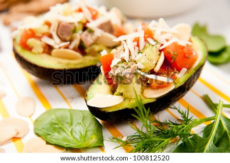 Organic Avocado Halves Filled with Tomatoes, Beef and Toasted Almonds for a Healthy Snack or Salad - stock photo