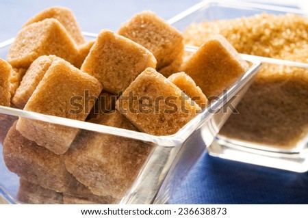 organic brown sugar in cubes and crystals