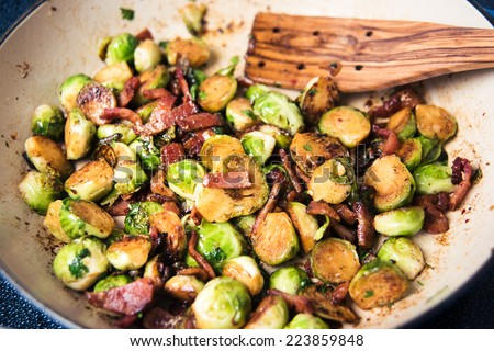 Organic Brussels Sprouts Sauteed with Bacon - stock photo