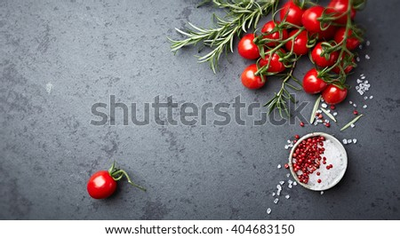 Organic cherry tomatoes with rosemary, sea salt and pink pepper - stock photo